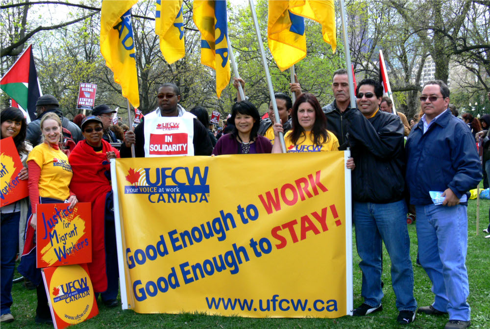 Olivia Chow stands with UFCW demonstrators