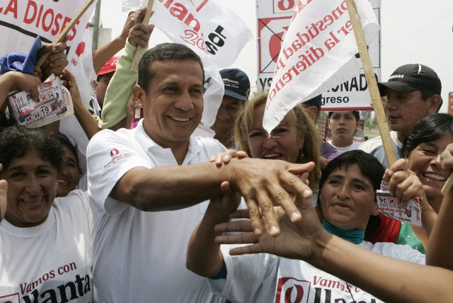 Gana Peru party leader and presidential candidate Ollanta Humala greets supporters during a campaign rally in Lima, Peru, March 24, 2011.